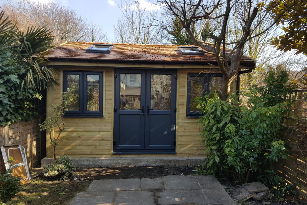 Insulated Garden Room with cedar shingles and velux windows
