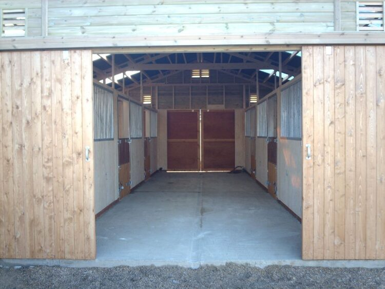 american barn built by Warwick Buildings with sliding doors