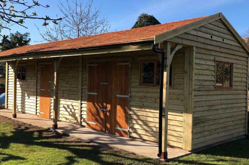 Cart lodge garage with cedar shingles and lined canopy
