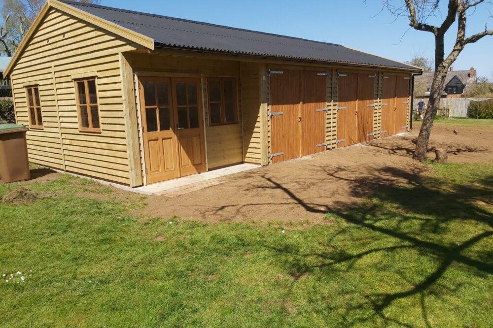 triple door timber garage