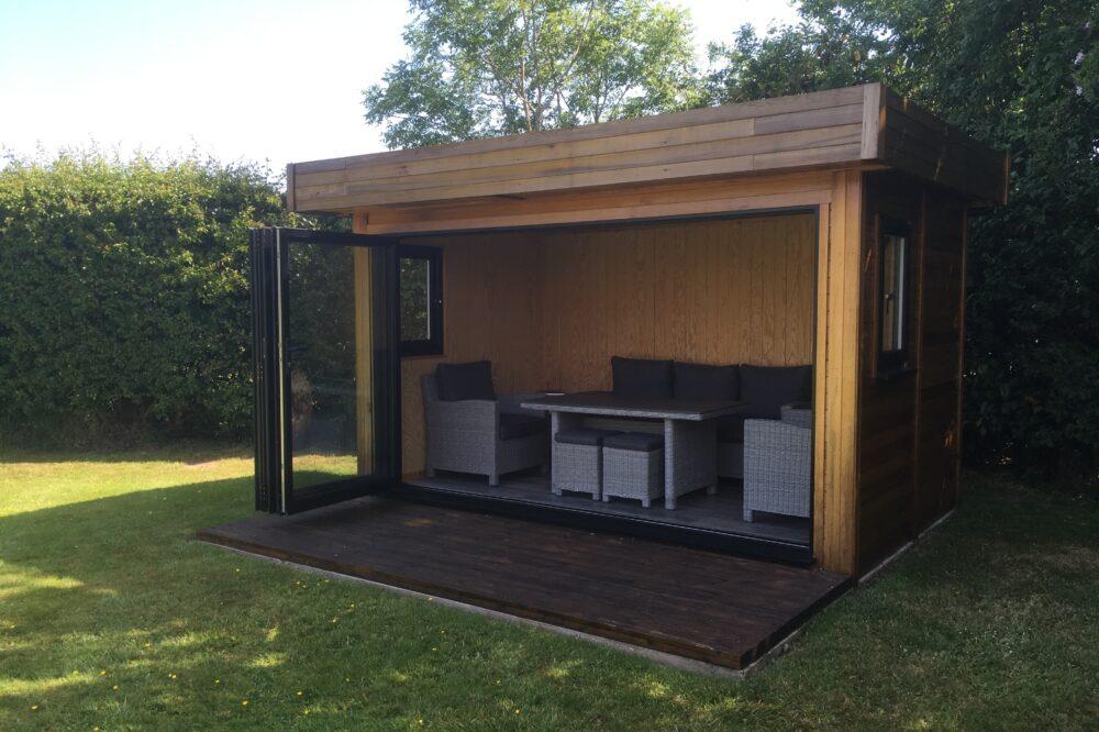 contemporary garden building with opened bi-fold doors