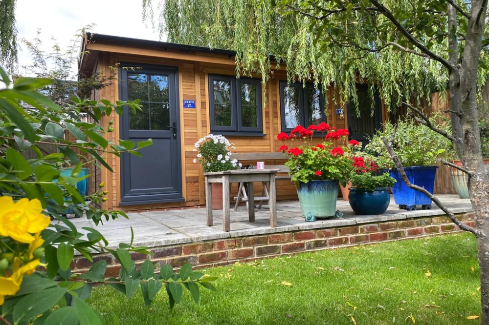Cedar Traditional Style garden room with Anthracite Grey doors and windows within back garden