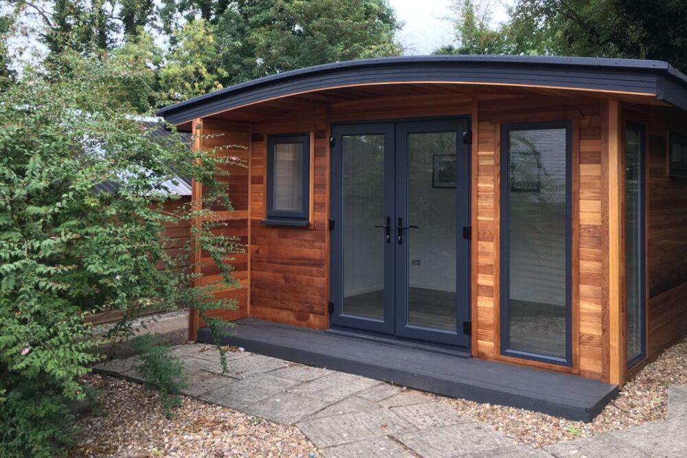 wooden curved roof garden room