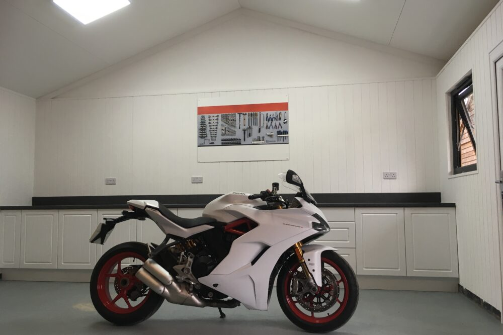 Inside garage with white motorcycle