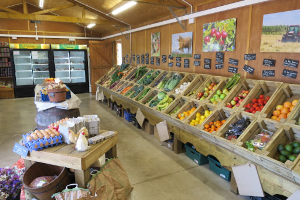 Fruit and veg stalls inside farm shop