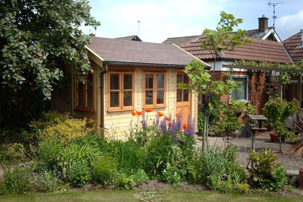 traditional garden sun room with wooden panels