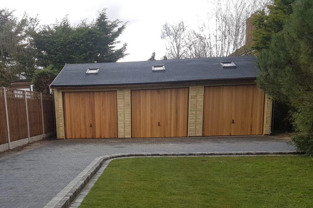 Three bay garage with cedar doors