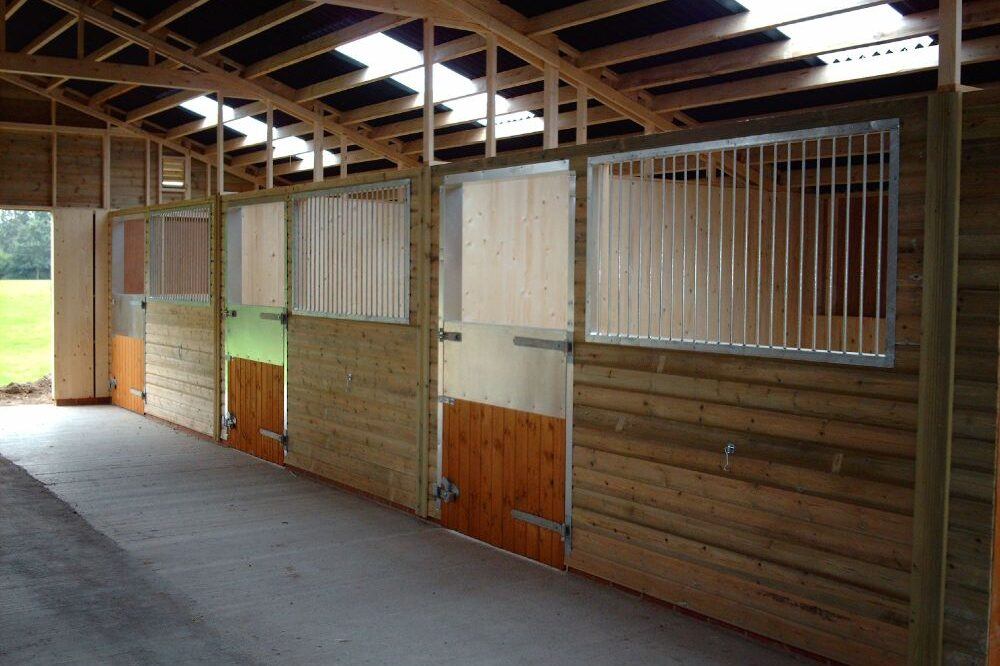 Inside of wooden stables