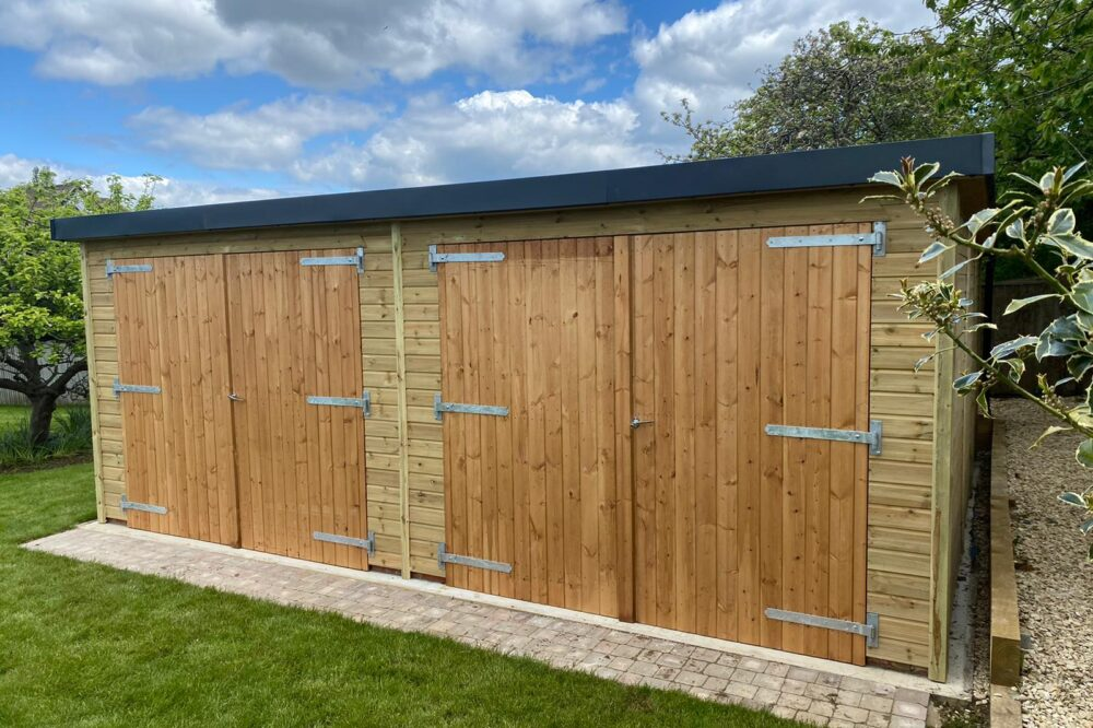 double door mono roof garage with black trim