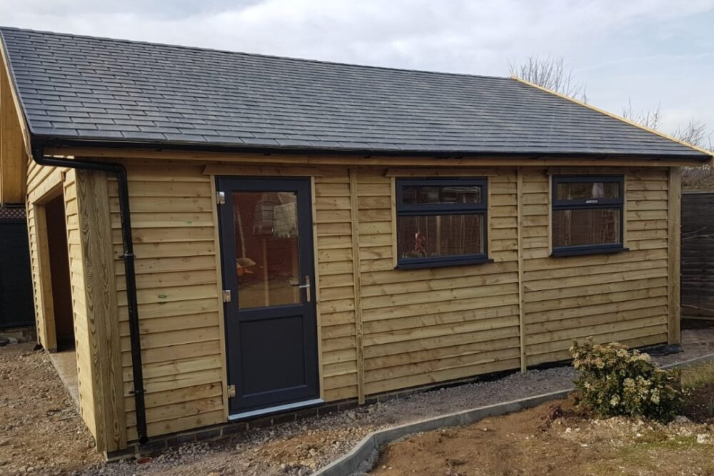 timber single garage with entrance door and windows