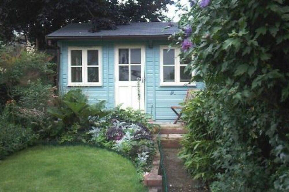Traditional blue garden studio