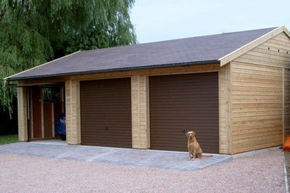 triple garage with dog sat in front