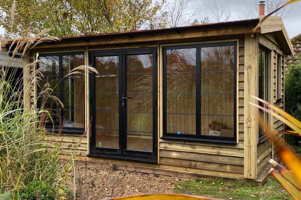garden studio clad with wooden feather edge boarding